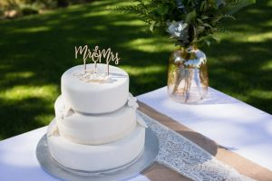 Decorated summer wedding cake on table