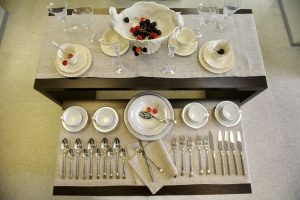 empty and clean dinnerware arranged beautifully on the shelf