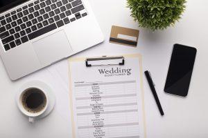 Wedding Planning text written on a clipboard, credit card